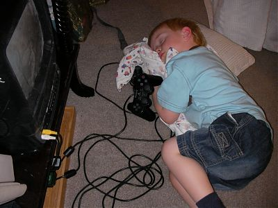Quinan asleep by the PS2