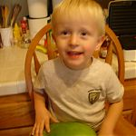 Quinan holding a watermelon.